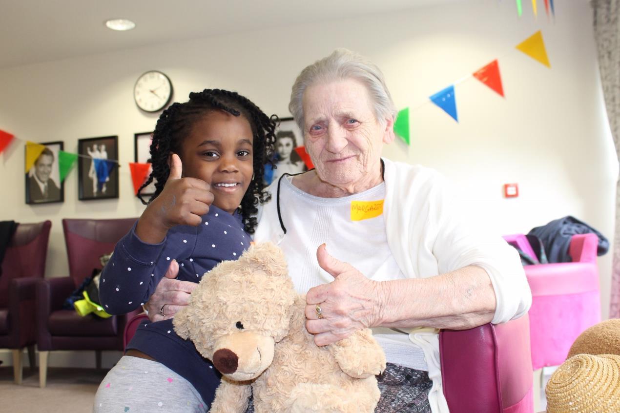 Karen Onodjo aged 4 with Margaret McColl aged 81.